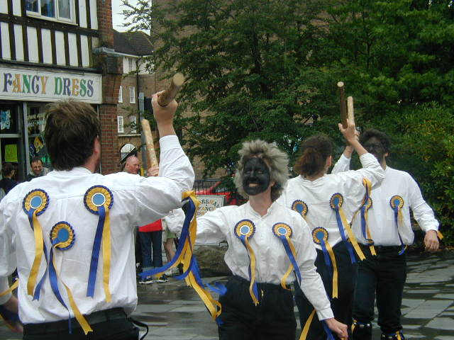 The team dancing in Horsham town centre, June 2001